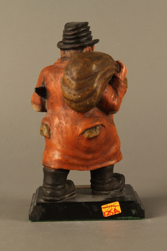 2016.184.152.3 back Painted wooden figurine of a Jewish schnorrer