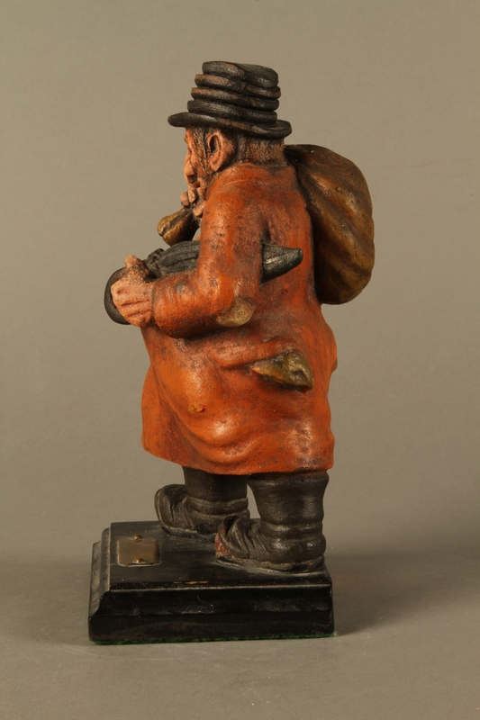 2016.184.152.3 left side Painted wooden figurine of a Jewish schnorrer