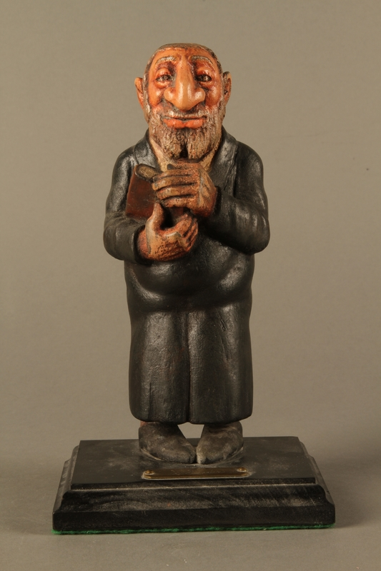 2016.184.152.4 front Hand carved and painted wooden figurine of a Rabbi