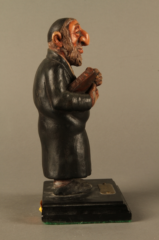 2016.184.152.4 right side Hand carved and painted wooden figurine of a Rabbi