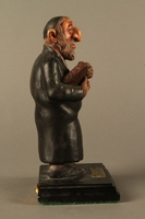 2016.184.152.4 right side Hand carved and painted wooden figurine of a Rabbi  Click to enlarge