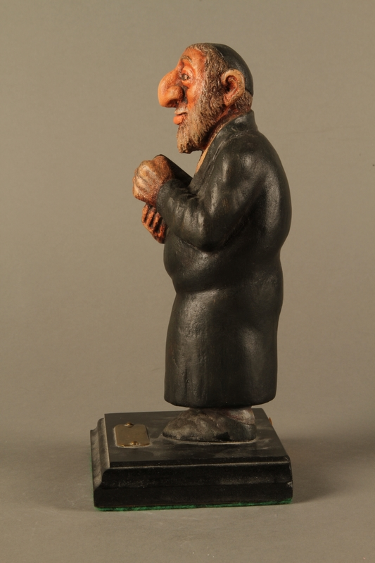 2016.184.152.4 left side Hand carved and painted wooden figurine of a Rabbi