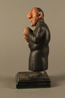2016.184.152.4 left side Hand carved and painted wooden figurine of a Rabbi  Click to enlarge