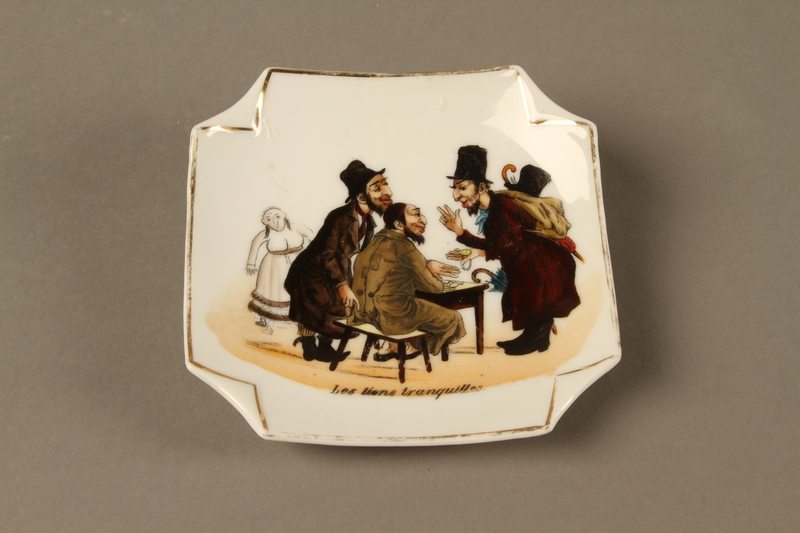 2016.184.153 front Porcelain plate with scene of a peddler's conference