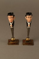 2016.184.154_a-b front Pair of painted candlesticks of a happy & a sad Jewish speculator  Click to enlarge