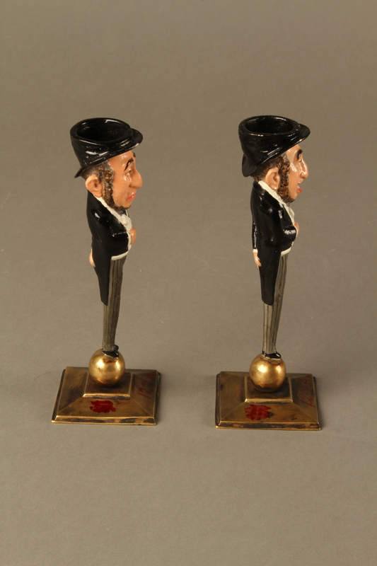 2016.184.154_a-b right Pair of painted candlesticks of a happy & a sad Jewish speculator