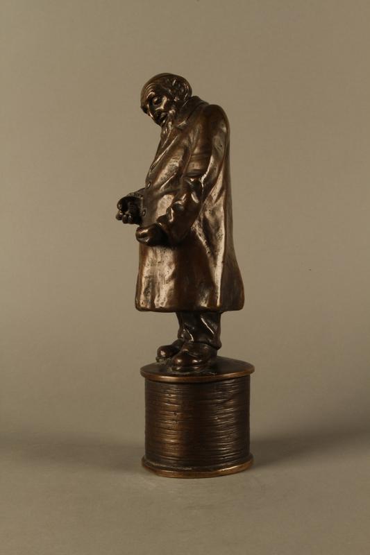 2016.184.155 left side Bronze statue of a Jewish money changer