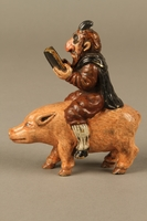 2016.184.206 right side Painted metal figurine of a horned Jewish man with hooves riding a pig  Click to enlarge