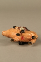 2016.184.206 bottom Painted metal figurine of a horned Jewish man with hooves riding a pig  Click to enlarge