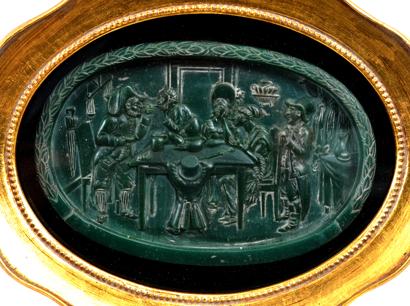 Wax plaque of a Jewish family waiting for a boy to pass swallowed money