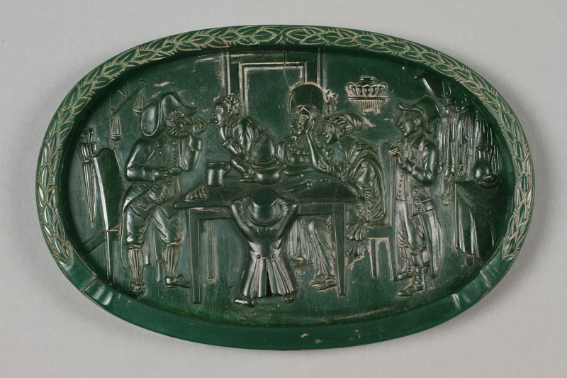 2016.184.208 front Wax plaque of a Jewish family waiting for a boy to pass swallowed money