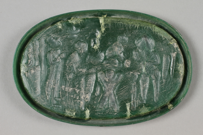 2016.184.208 back Wax plaque of a Jewish family waiting for a boy to pass swallowed money