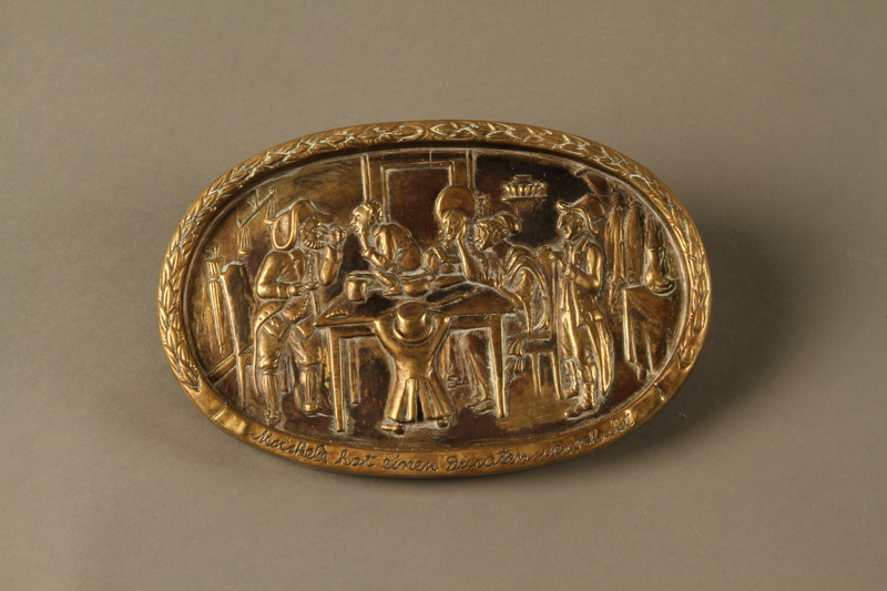 2016.184.209 front Bronze dish of a Jewish family waiting for a boy to pass swallowed money
