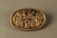 2016.184.209 front Bronze dish of a Jewish family waiting for a boy to pass swallowed money  Click to enlarge