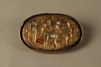 2016.184.209 back Bronze dish of a Jewish family waiting for a boy to pass swallowed money  Click to enlarge