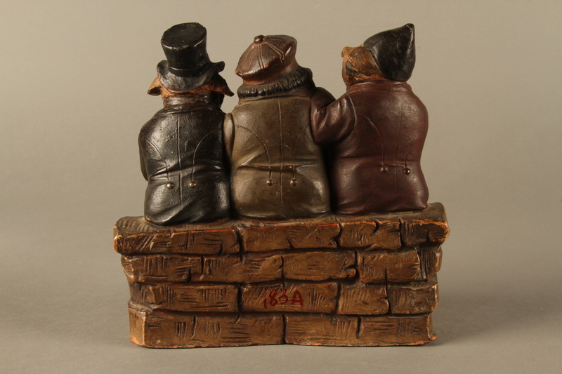 2016.184.211 back Ceramic figure group with 3 pigs as the stereotypical 3 Jews on a bench