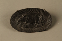 2016.184.210 front Iron dish with a Jewish man passing horizontally through a pig  Click to enlarge