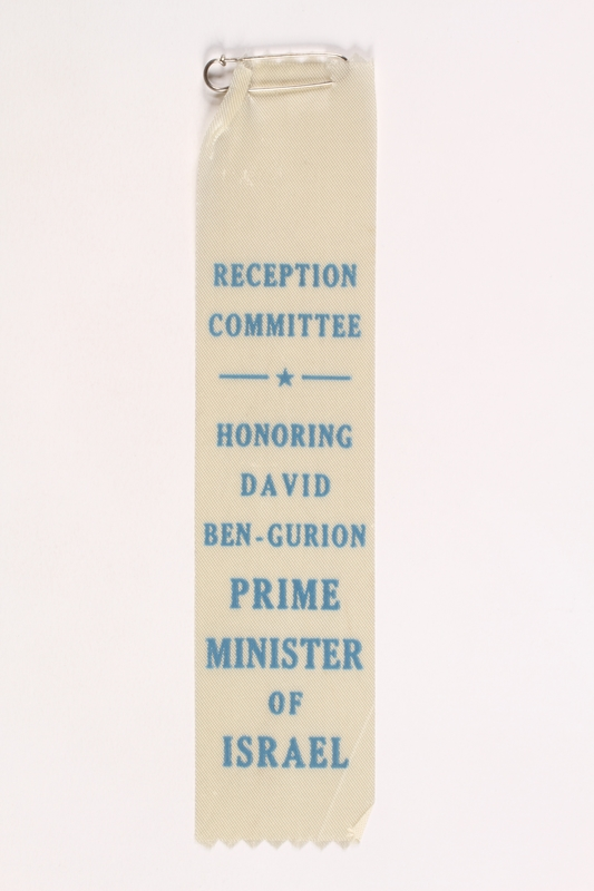 2007.162.2 front Commemorative ribbon worn by a director of the Deggendorf DP camp