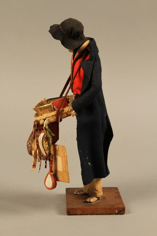 2016.184.254_a leftt side Hand crafted figure of a Jewish peddler