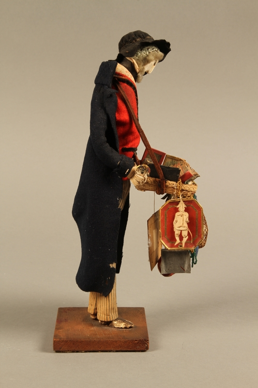 2016.184.254_a right side Hand crafted figure of a Jewish peddler