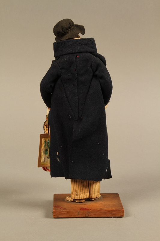 2016.184.254_a back Hand crafted figure of a Jewish peddler