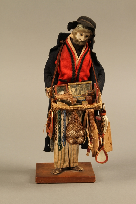 2016.184.254_a front Hand crafted figure of a Jewish peddler