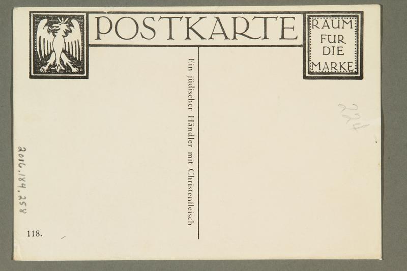 2016.184.258 back Postcard of a Jewish merchant peddling a Christian woman