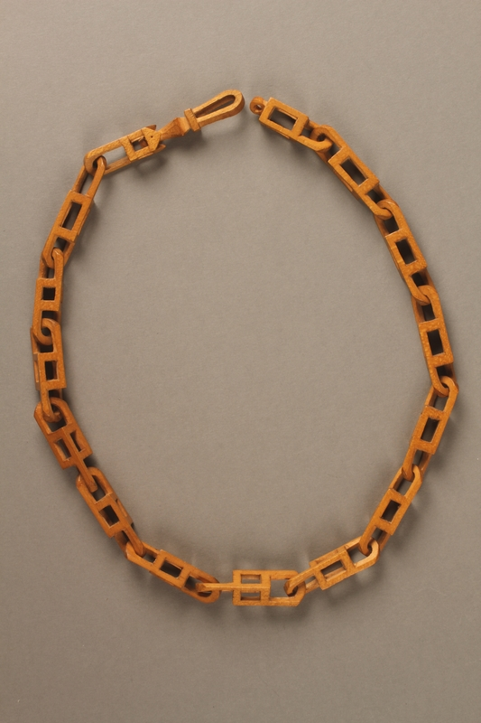 2016.183.1 side A Wooden chain carved in a transit camp by a Jewish man deported to his death