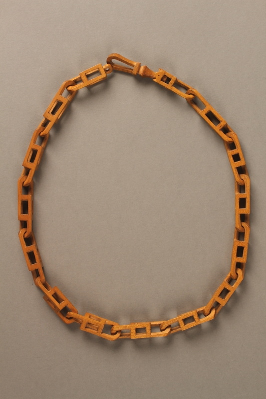 2016.183.1 side B Wooden chain carved in a transit camp by a Jewish man deported to his death