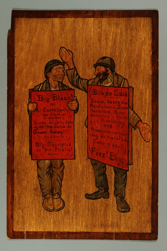 2016.184.290 front Wood panel painting of 2 Jewish men with fire sale sandwich boards