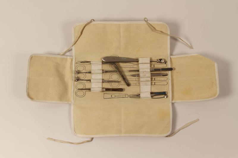 1999.91.2.1-.9 open Medical kit