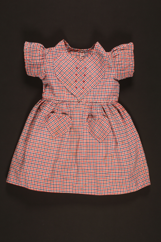 2016.112.2 front Checkered dress with heart patches made for a young Austrian Jewish refugee before her emigration