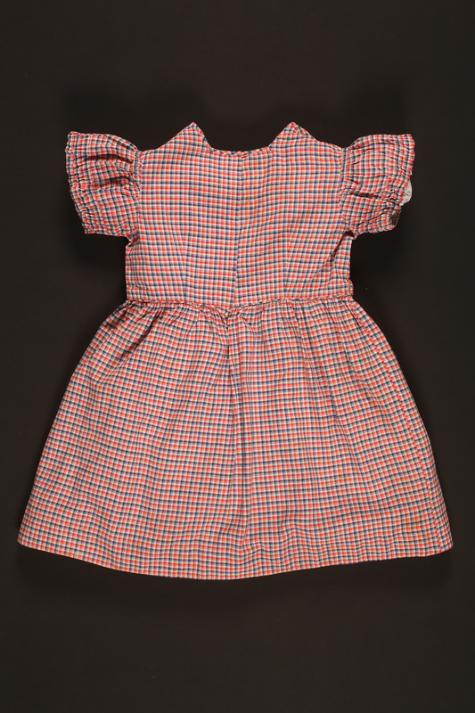 2016.112.2 back Checkered dress with heart patches made for a young Austrian Jewish refugee before her emigration