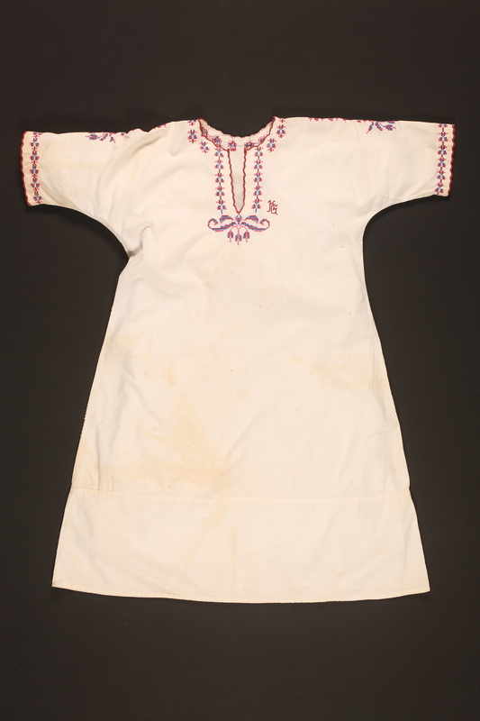 2016.112.4 front Embroidered nightgown made for a young Austrian Jewish refugee before her emigration