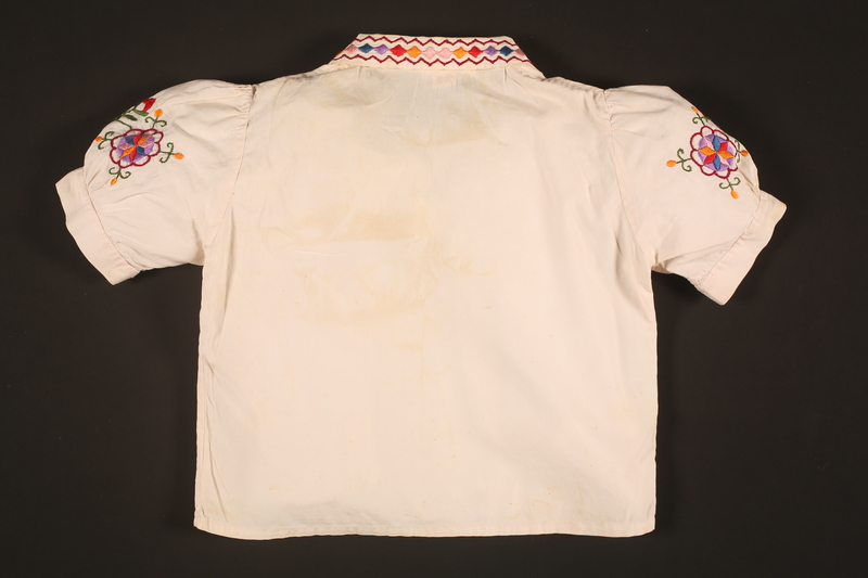 2016.112.5 back Embroidered blouse made for a young Austrian Jewish refugee before her emigration