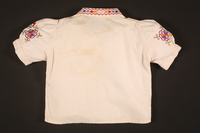 2016.112.5 back Embroidered blouse made for a young Austrian Jewish refugee before her emigration  Click to enlarge
