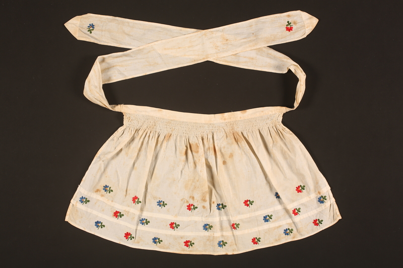2016.112.6 front Embroidered apron made for a young Austrian Jewish refugee before her emigration