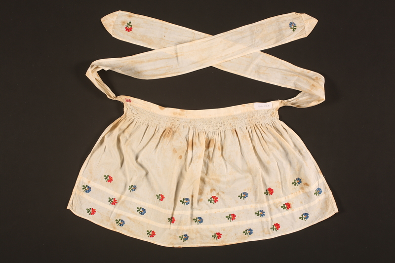 2016.112.6 back Embroidered apron made for a young Austrian Jewish refugee before her emigration