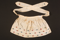 2016.112.6 back Embroidered apron made for a young Austrian Jewish refugee before her emigration  Click to enlarge