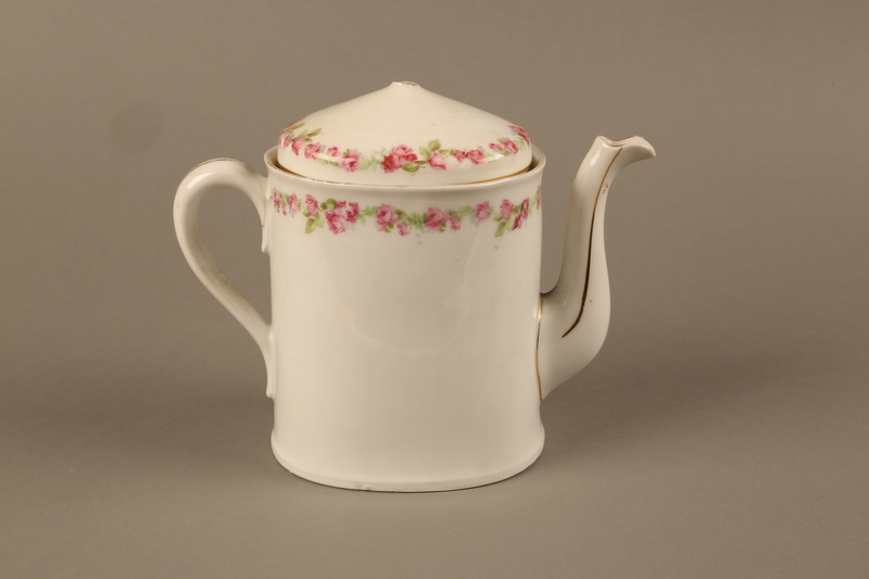 2016.121.1_a-b back Porcelain teapot and lid used by a Hungarian Jewish family