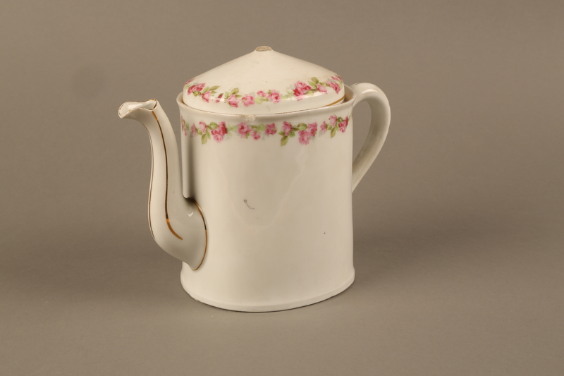 2016.121.1_a-b 3/4 view Porcelain teapot and lid used by a Hungarian Jewish family