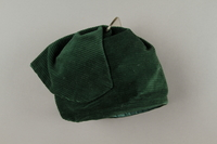 2016.121.7 left Green corduroy hat worn by a Hungarian Jewish woman  Click to enlarge