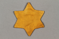 2016.121.9 side a Yellow cloth Jewish star  Click to enlarge
