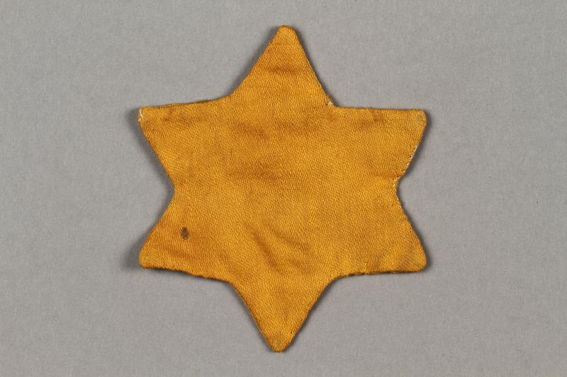2016.121.9 side b Yellow cloth Jewish star