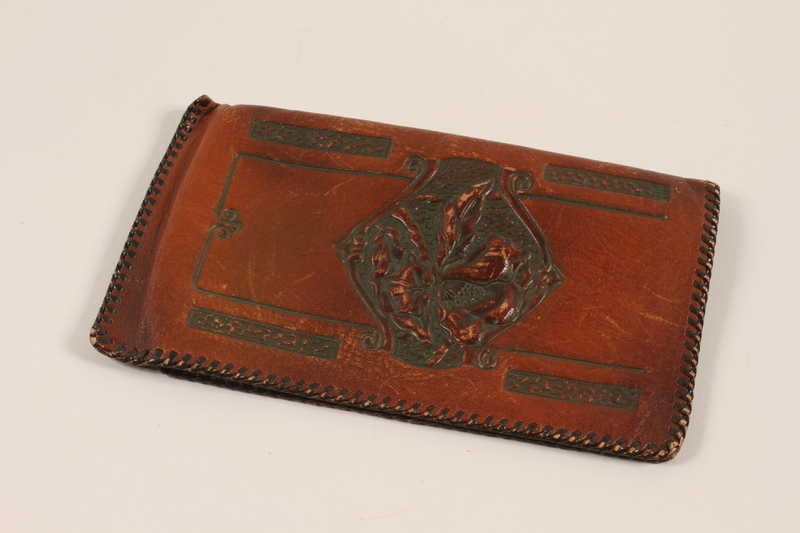2012.409.2 front Leather wallet with an embossed floral design used by a Hungarian Jewish youth and former concentration camp inmate