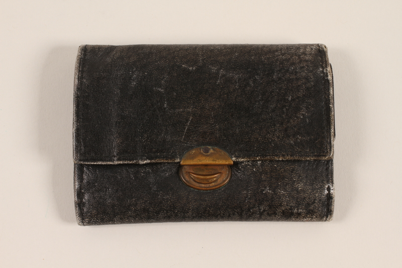 2012.409.3 closed Black textured leather trifold wallet used by a Hungarian Jewish youth and former concentration camp inmate