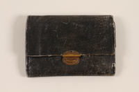 2012.409.3 closed Black textured leather trifold wallet used by a Hungarian Jewish youth and former concentration camp inmate  Click to enlarge