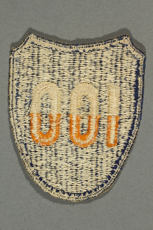 2016.187.2 back US Army 100th Infantry Division patch worn by a Jewish emigre soldier
