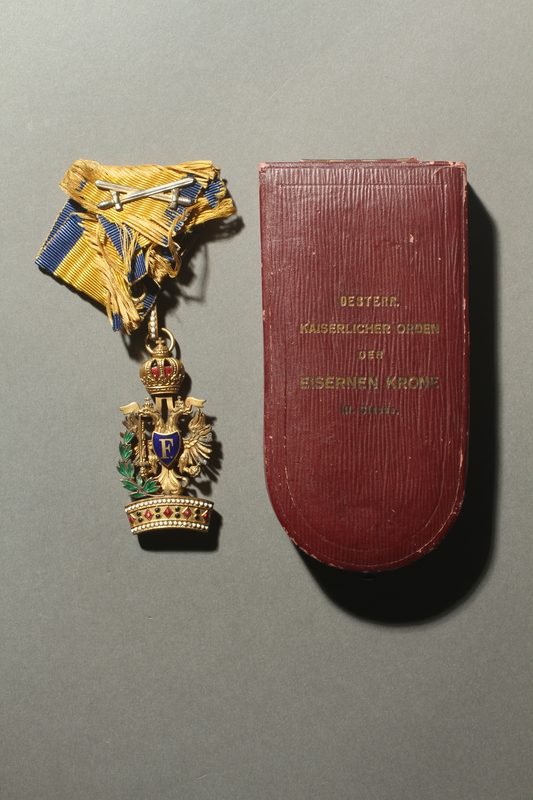 2016.458.4 a-c front World War I Austrian Order of the Iron Cross medal, ribbon, and presentation box
