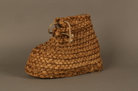 2016.255.1b 3/4 view Pair of straw boots with felt liners  Click to enlarge